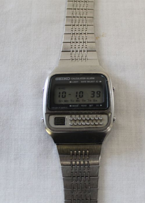 Vintage steel cased Seiko calculator wristwatch with digital dial on bracelet strap, the back