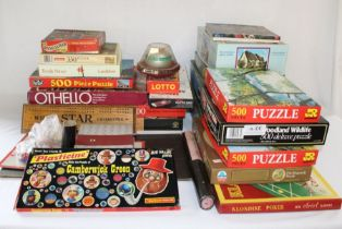 Selection of board games including Monopoly, rubik's cubes, jigsaw puzzles, Camberwick Green