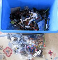 Large container containing assorted Lego (unchecked), Transformers and action figures etc