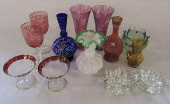 Assorted coloured glassware