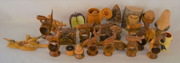 Various carved wooden items including animal napkin rings etc