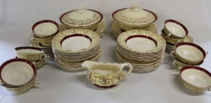 Pallisy burgundy and gold part dinner service, approximately 55 pieces