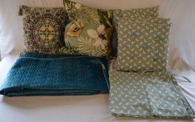 2 elaborate cushions, blanket, 4 patio chair cushions & a matching table cloth (all as new)