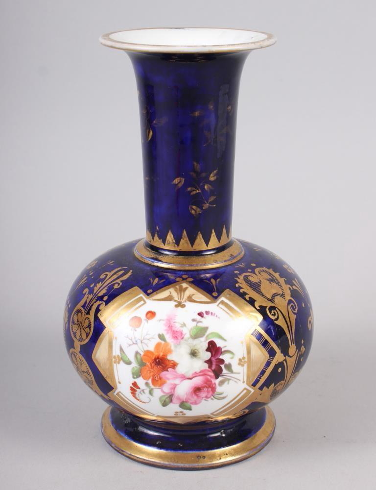 A 19th century bone china bulbous vase, decorated with panels of flower on a blue and gilt ground, 8