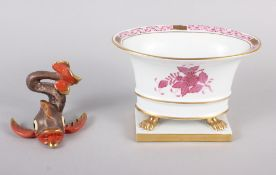 """A Herend menu card holder, formed as a dolphin with gilt decoration, 3"""" high, and a Herend oval bowl"""