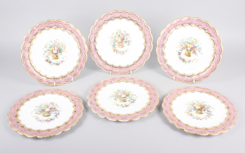 Six 19th century bone china plates, decorated with baskets of flowers and fruit with pink and gilt