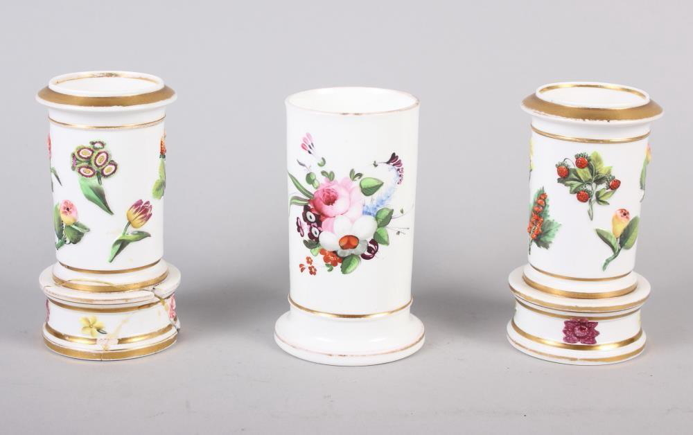 "A pair of Spode relief and floral decorated spill vases, 4 1/4"" high, and a similar spill vase, 4"""