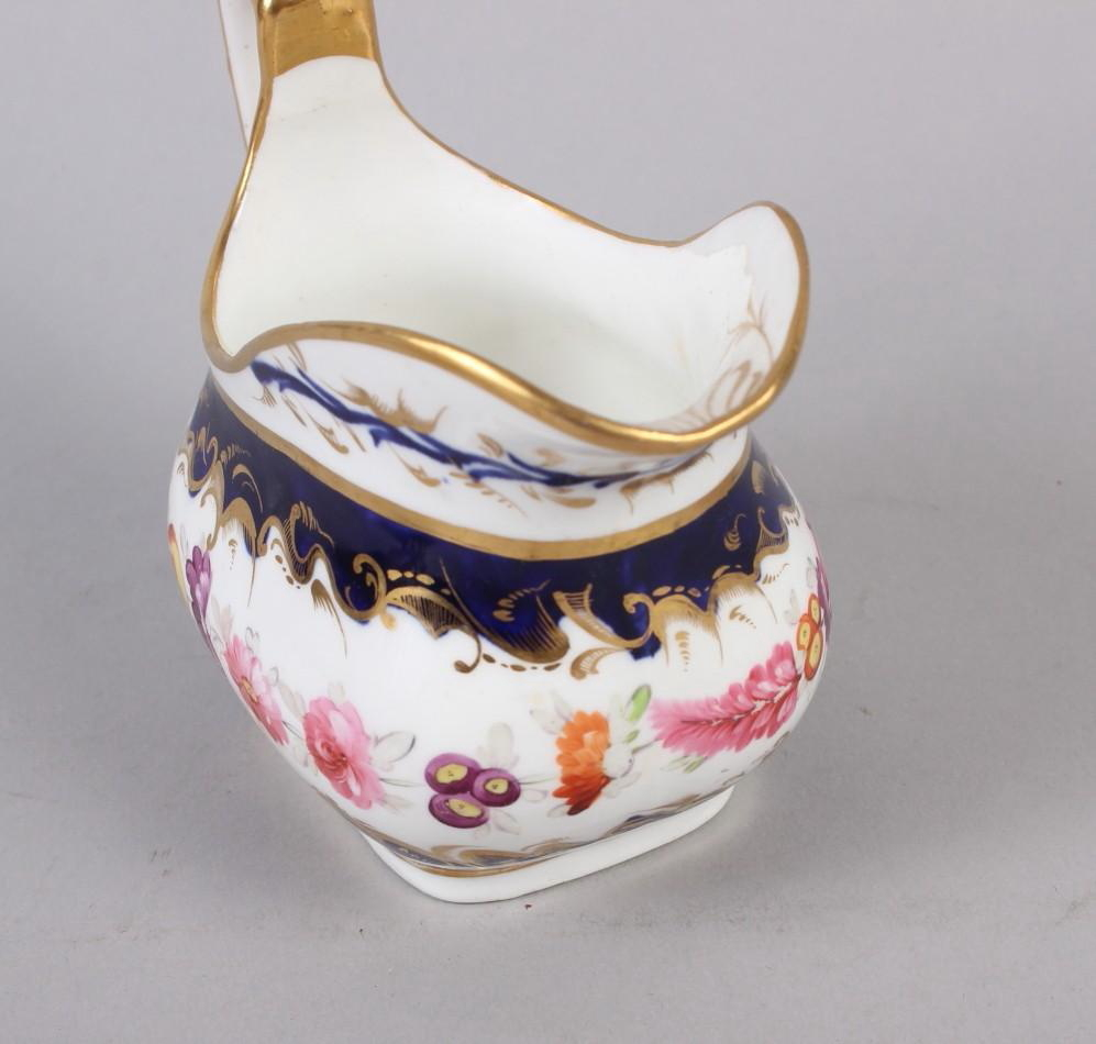 A 19th century bone china bulbous vase, decorated with panels of flower on a blue and gilt ground, 8 - Image 14 of 15