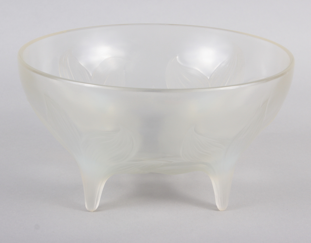 "An R Lalique ""Lys"" pattern opalescent glass bowl, on four raised feet, 9 1/2"" dia (chip)"
