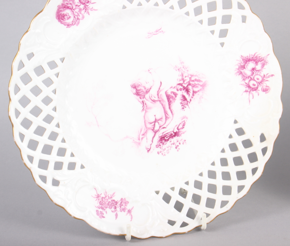 """A pair of bone china plates with puce cherub and floral decoration with pierced borders, 9 1/2"""" dia - Image 2 of 5"""
