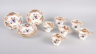 A 19th century English porcelain part tea service for six, in the Imari palette with gilt highlights