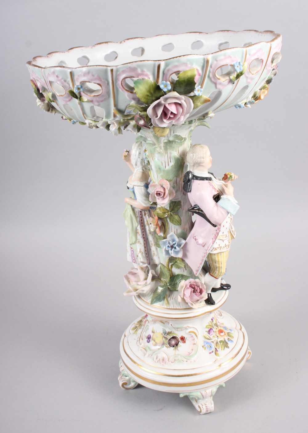 A Continental porcelain table centre, the stem decorated with two figures and floral decoration to - Image 3 of 15