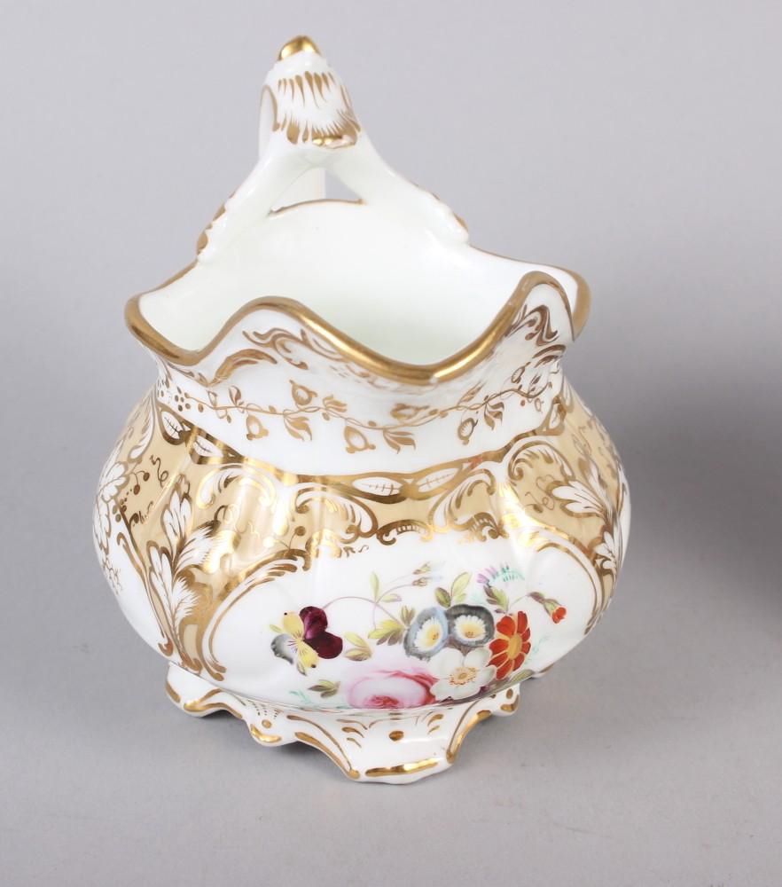 A 19th century bone china bulbous vase, decorated with panels of flower on a blue and gilt ground, 8 - Image 8 of 15