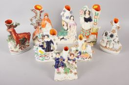 """Eight Staffordshire figure spill vases, including Little Red Riding Hood, 10"""" high, and two babes in"""