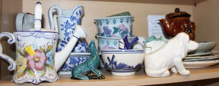 A blue and white toilet jug and basin, a pair of planters, on stands, a floral decorated watering
