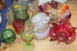 A Victorian cranberry glass table centre, an iridescent shell-shaped table centre, a paperweight,
