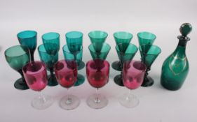 A set of six 19th century green glass conical wines, an early 19th century green glass rum