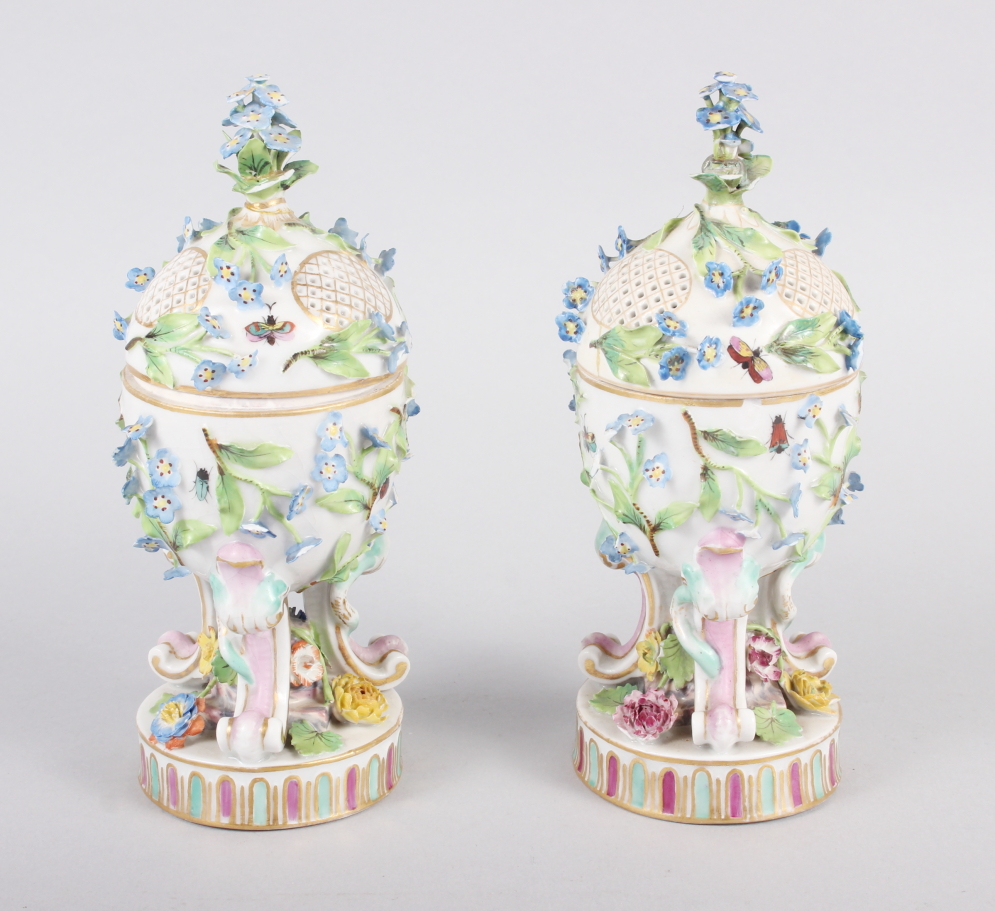 A pair of pot pourri jars with hinged covers and insect and relief floral decoration