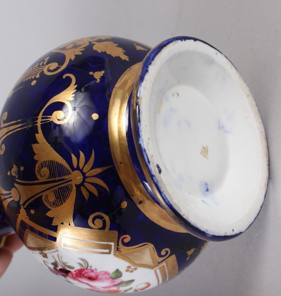 A 19th century bone china bulbous vase, decorated with panels of flower on a blue and gilt ground, 8 - Image 5 of 15