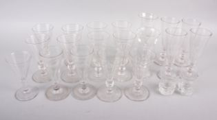 A set of six 19th century conical wines, engraved with dragons and monogram faceted knop stems,