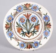 """A Thun type wall plate with floral decoration, 9 3/4"""" dia"""