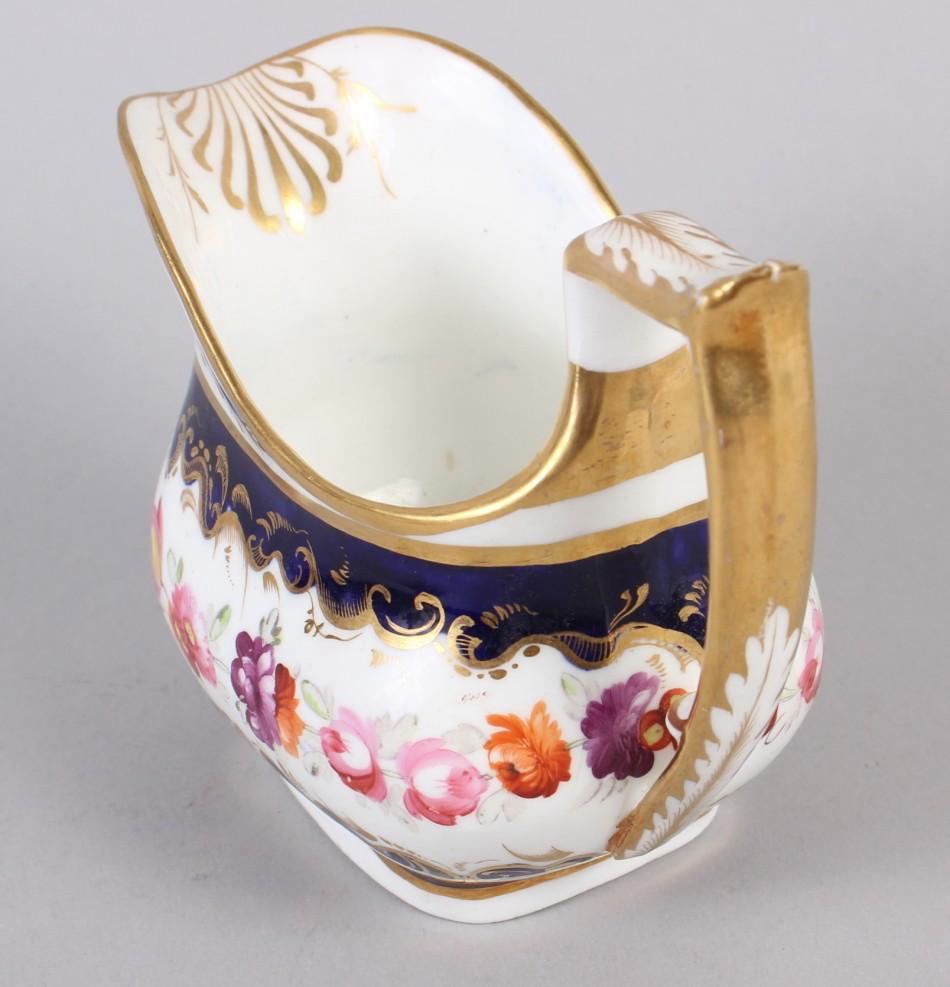 A 19th century bone china bulbous vase, decorated with panels of flower on a blue and gilt ground, 8 - Image 12 of 15