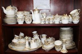 A Noritake 44318 pattern part combination service, comprising three coffee pots, a cheese dish,