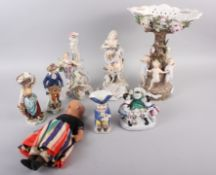 """A Continental centrepiece with dancing children and relief flower decoration, 14"""" high, two"""