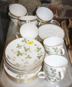 """A Wedgwood bone china """"Wild Strawberry"""" pattern part tea service for six and a Royal Doulton bone"""
