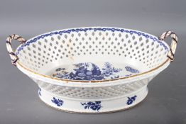 """A Worcester porcelain chestnut basket with swag decorated border and crescent mark to base, 13"""" wide"""