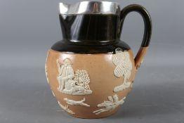 """A Royal Doulton silver mounted hunting jug, 6 1/4"""" high"""