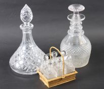 A 19th century Palais Royale type gilt metal basket, containing six cut glass scent bottles and