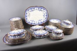 A Royal Crown Derby blue and white part dinner service, decorated floral swags with gilt borders,