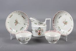A Newhall (Factory X) cream jug (hair crack) and a pair of similar fluted tea bowls and saucers (
