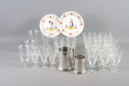 Two Quimper figure decorated plates, two pewter tankards and a selection of cut and other glass