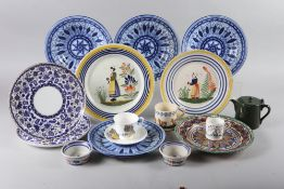 Two Quimper figure decorated plates, four blue and white tin glazed plates, a number of Doulton bone