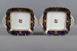 """A pair of Coalport porcelain dishes with gilt armorial decoration, 9 1/2"""" wide"""