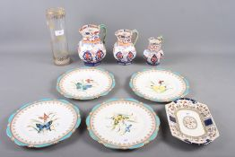 """Three Fenton Stoneworks jugs, tallest 7"""" high, four Bisto plates, decorated butterflies (damages), a"""