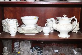 A mid 19th century bone china and gilt decorated matched part tea service, including teapot, cream