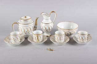 A mid 19th century French porcelain gilt scroll decorated part coffee service