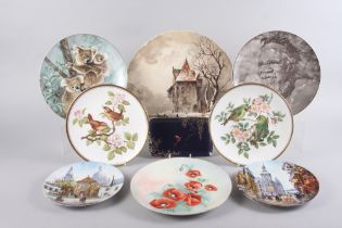 A pair of Royal Worcester bird decorated wall plates, a late 19th century landscape decorated