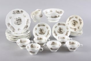 An early 19th century bone china part teaset with bat printed landscape decoration (some damages)