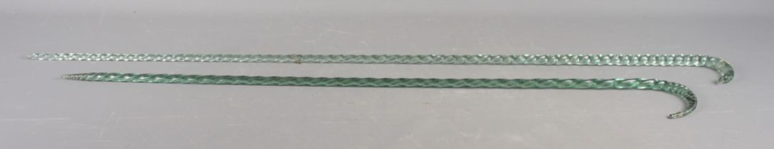 "Two twisted glass walking sticks, 44"" long and 38"" long (chipped)"