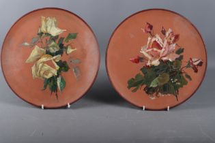 "A pair of Watcombe terracotta plates, decorated roses, 12 1/2"" dia (one chip to rim)"