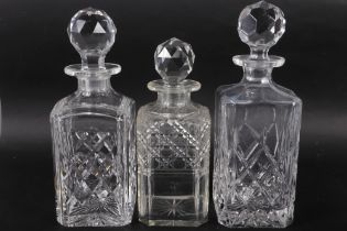 An early 20th century whisky decanter (small chips to stopper), two other whisky decanters (