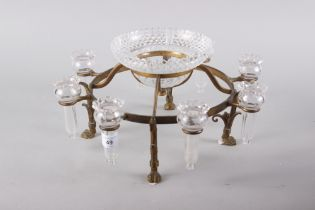 A quantity of uranium glasses, a pair of table salts and a gilt metal table centre