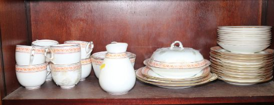 A late 19th century blue china orange and gilt decorated part breakfast service including muffin
