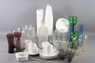 "A Rosenthal white glazed cylindrical vase, 10"" high, a similar vase, 12 1/4"" high, a Stonehenge"