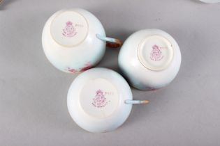 A Royal Worcester cabaret teaset with pink floral decoration and gilt borders, ten pieces approx (
