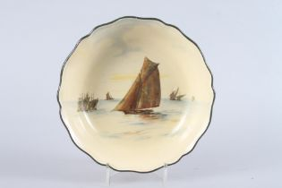 "A Royal Doulton fruit bowl, decorated sailing boats on a yellow ground, 9 1/2"" dia"